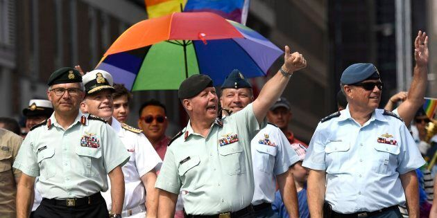 Chief of the Defence Staff Jonathan Vance, centre, marches in the Ottawa Capital Pride parade on Aug....