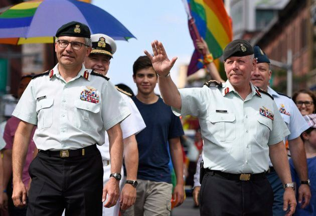 Chief of the Defence Staff Jonathan Vance, right, marches in the Ottawa Capital Pride parade, the first...