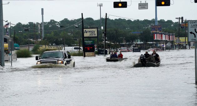 Flood waters from Hurricane Harvey cover the main street in Dickinson, Texas August 27. Gas prices are...