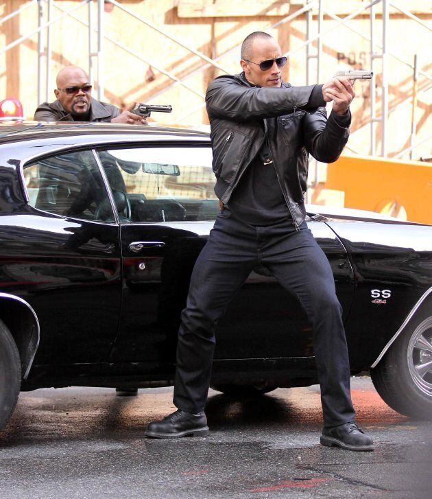 """Dwayne """"The Rock"""" Johnson and Samuel L. Jackson film a shoot-out scene for their new film 'The Other Guys,' April, 2014. (Photo by Philip Ramey/Corbis via Getty Images)"""