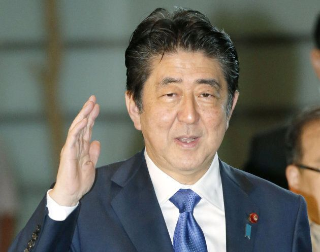 Japanese Prime Minister Shinzo Abe arrives at his official residence in Tokyo in this photo taken by...