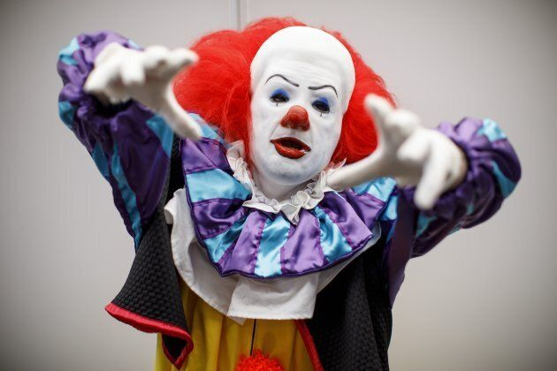 A cosplayer dressed as Pennywise the Dancing Clown attends London Super Comic Convention at Business...
