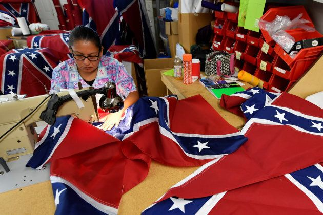 Blanca Hernandez sews stars on a Confederate Battle Flag in the Alabama Flag & Banner shop in Huntsville,...