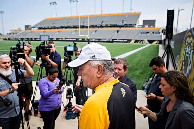 Hamilton Tiger-Cats head coach June Jones speaks to the media about the joint team and CFL decision to...