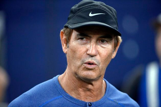 Former Baylor football coach Art Briles watches the Dallas Cowboys and the Chicago Bears warm up for...