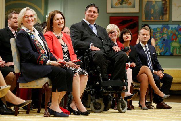 Carolyn Bennett, Jane Philpott, Kent Hehr, Carla Qualtrough, Ginette Petitpas Taylor and Seamus O'Reagan take part in a cabinet shuffle at Rideau Hall in Ottawa, on Aug. 28, 2017.