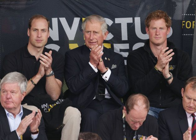 The Duke of Cambridge, Prince Charles and Prince Harry during day two of the Invictus Games Athletics competition, at Lee Valley Athletics Centre, London