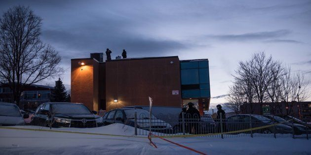 Police stand guard on the roof of the Islamic Cultural Center in Quebec City, Canada prior to the arrival...