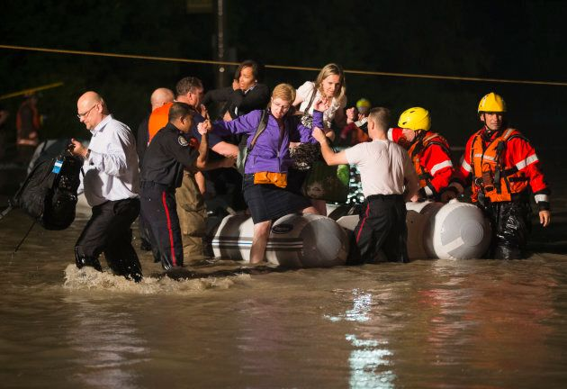 A dingy full of passengers that were stranded on a GO Train is rescued during a heavy rainstorm in Toronto...
