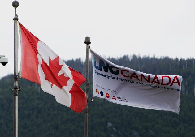 Canadian and LNG Canada flags fly outside of the company's office in Kitimat, B.C.