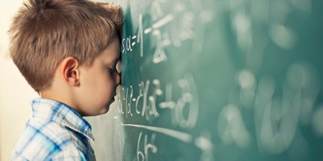 A little boy in math class overwhelmed by