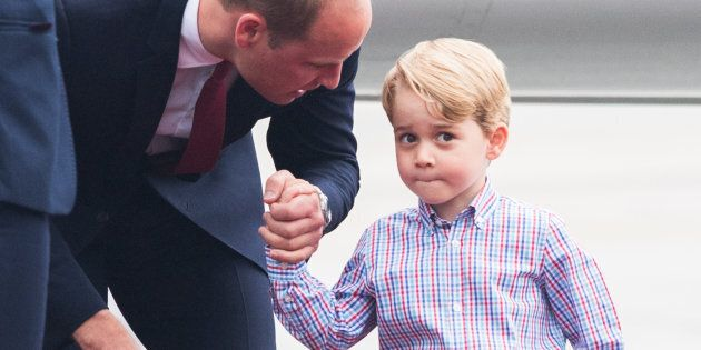 Prince William and Prince George of Cambridge arrive at Warsaw airport in July 2017. (Photo by Samir...