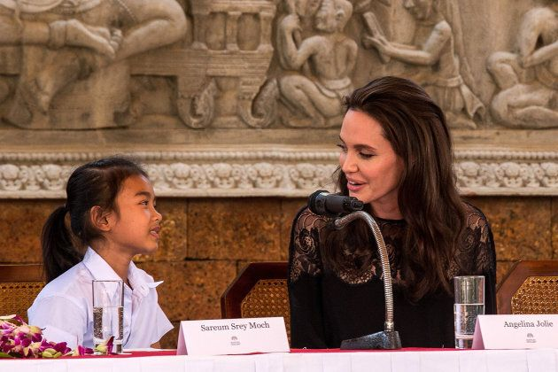 Angelina Jolie talks to actress Sareum Srey Moch during a press conference ahead of the premiere of their...