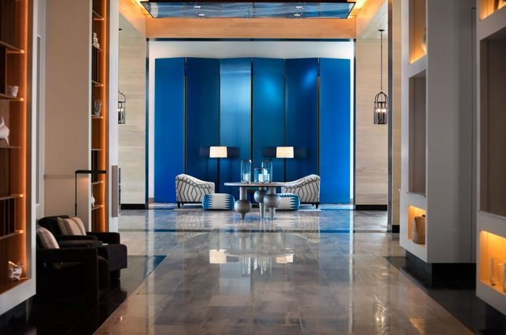 The cool blue tones of the lobby provide an impressive welcome.