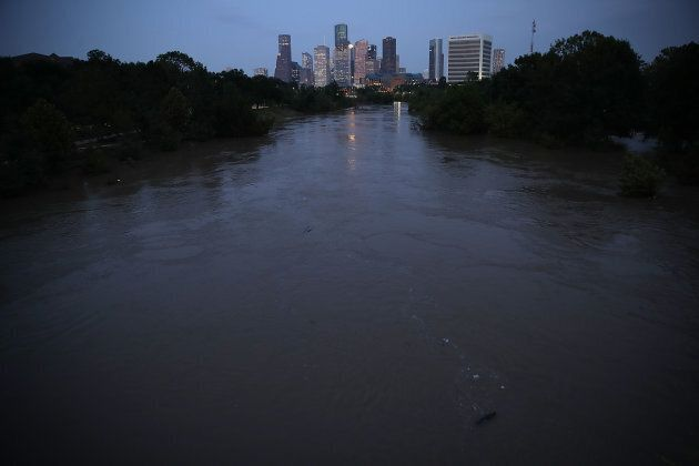 Buffalo Bayou, swollen with floodwaters in the wake of Hurricane Harvey, is shown with the Houston skyline...