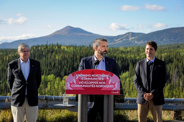 Yukon Premier Sandy Silver, centre, speaks Saturday on the $360 million package to improve highways in...
