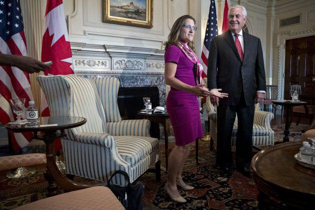 Chrystia Freeland, Canada's minister of foreign affairs, left, speaks as Rex Tillerson, U.S. secretary...