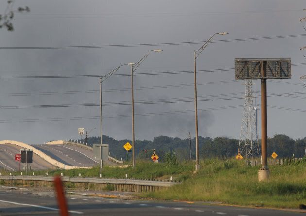 Smoke is seen rising from the Arkema chemical manufacturing and storage facility that burst into flames...