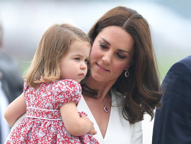 Will it be another girl? Princess Charlotte and mum Kate arrive at Warsaw airport on July 17, 2017 in...
