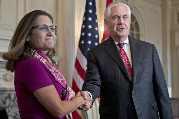 Rex Tillerson, U.S. secretary of State, right, shakes hands with Chrystia Freeland, Canada's minister...