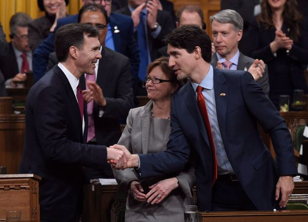 Prime Minister Justin Trudeau, right, shakes hands with Minister of Finance Bill Morneau following his...