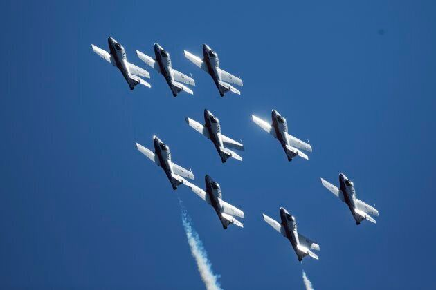 A CF Snowbirds fly-by roars through the sky during day one of the Canadian International Air Show in...