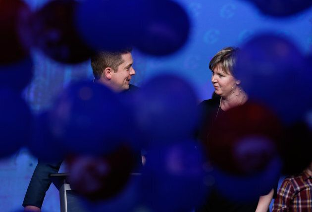 Balloons drop around Andrew Scheer and his wife Jill after winning the leadership during the Conservative...