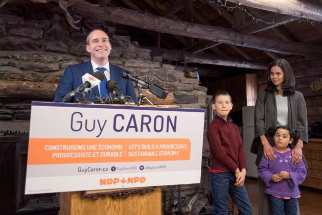 Guy Caron stands with his son Dominic, 8, daughter Edith, 5, and wife Valerie Stansfield as he announces...