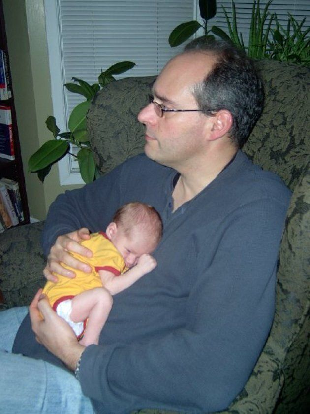 Guy Caron with his first-born, son Dominic, one day after he was born in Jan.