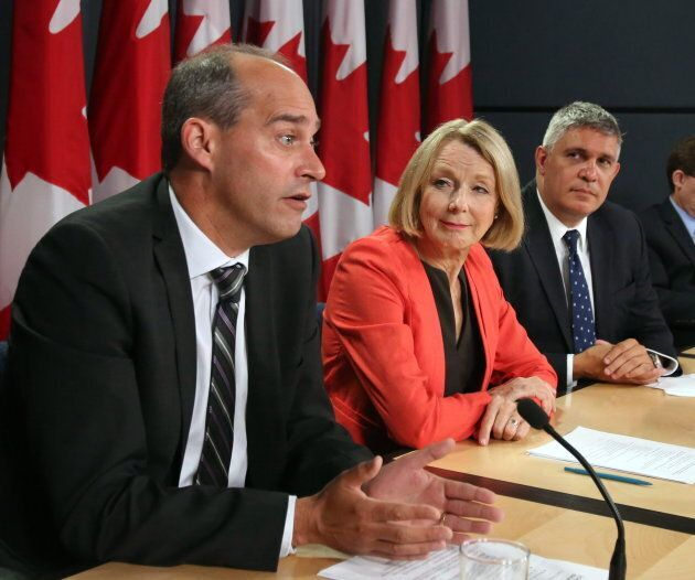 Guy Caron appears with NDP candidates Peggy Nash and Andrew Thomson at a news conference in Ottawa on...