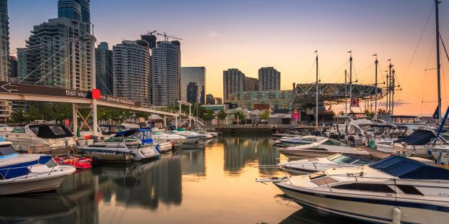 Sailboats in a marina in Toronto harbour. Toronto is one of four cities in Canada where the average household...