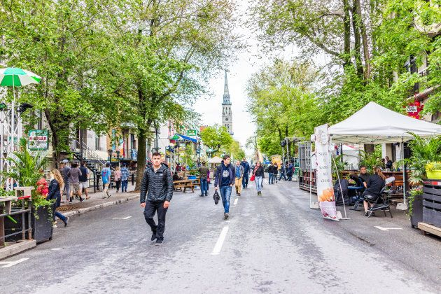 People walk on Saint Denis Street in Montreal's Plateau Mont Royal