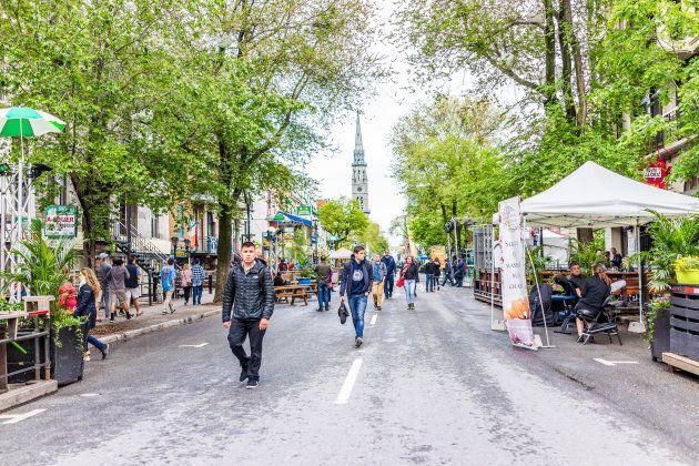 People walk on Saint Denis Street in Montreal's Plateau Mont Royal neighbourhood.