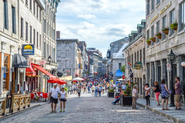 People walk around on the popular St. Paul street in Montreal's Old Port on June 6,