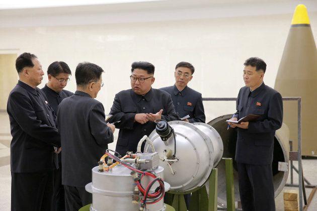 North Korean leader Kim Jong Un provides guidance with Ri Hong Sop (3rd L) and Hong Sung Mu (L) on a...