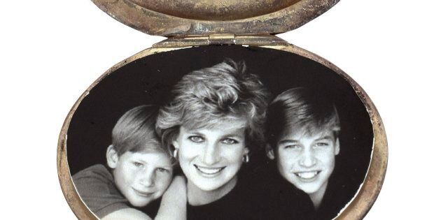 This August 2017 photo provided by RR Auction shows a locket containing a photograph of Princess Diana...