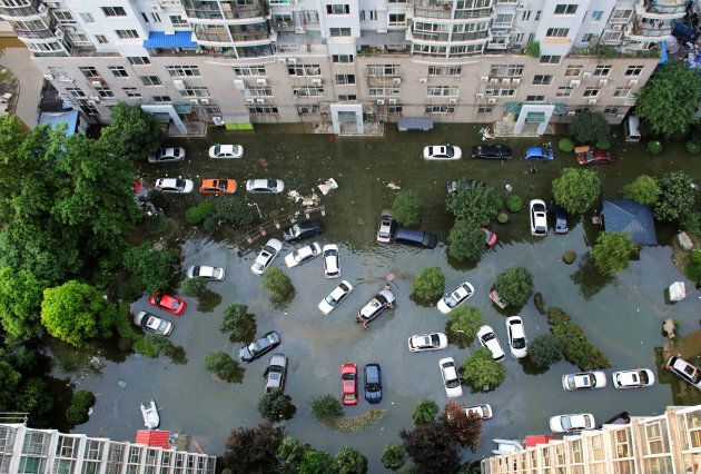 Automobiles are seen flooded at a neighbourhood in Wuhan, Hubei province, China July 9, 2016. The municipality...
