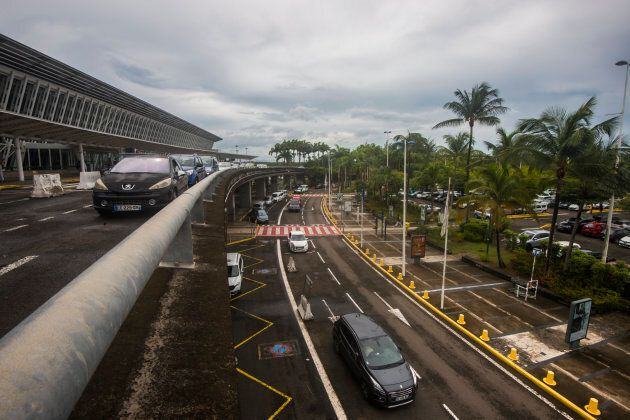Cars drive past a terminal at the Pole Caraibes international airport in Pointe-a-Pitre, which re-opened on Sept. 6, 2017, after hurricane Irma hit the island.