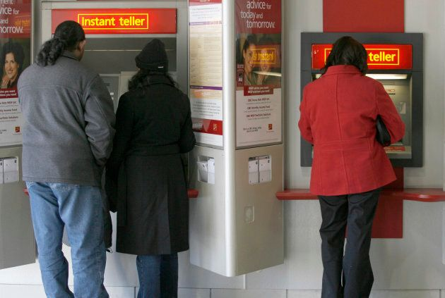 Customers use an automated teller machine (ATM) at a CIBC branch in Mississauga, Ont., February 23, 2007....