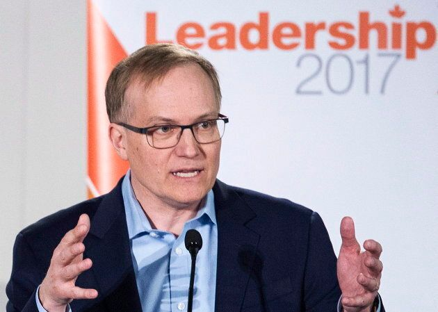 NDP leadership candidate Peter Julian makes a point during a leadership debate in Montreal on March 26,