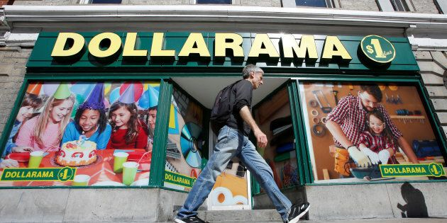 A pedestrian walks past a Dollarama store in Ottawa, Ont., Sept. 1, 2016. Shares of the retail giant...