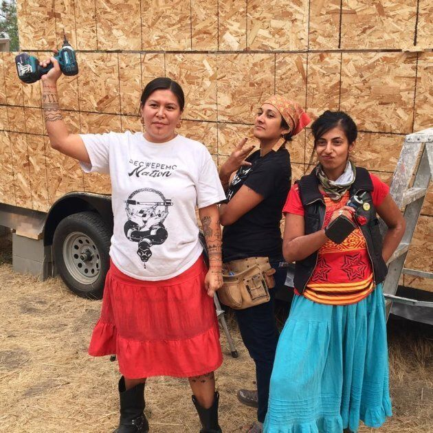 Kanahus Manuel, left, came up with the idea of building tiny homes after attending the Standing Rock protest.