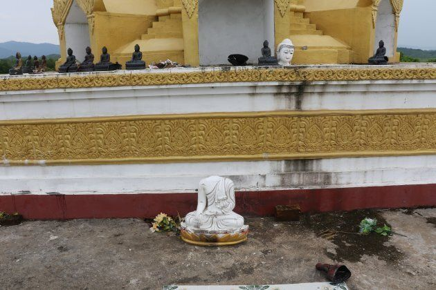 A decapitated Buddhist statue, allegedly committed by a militant group as communal violence between Buddhists...