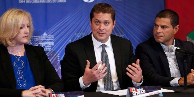 Conservative Leader Andrew Scheer speaks, as Lisa Raitt and Alain Rayes listen in at his shadow cabinet...