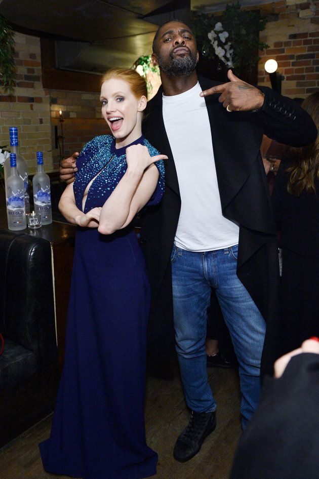 Jessica Chastain and Idris Elba pose together at the MOLLY'S GAME premiere party hosted by Grey Goose....