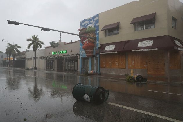Debris blown around by high winds is seen in the street as hurricane Irma arrives on Sept. 10, 2017 in...