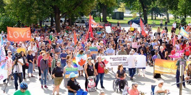 Hundreds of demonstrators rallied in Winnipeg on Saturday in opposition to a protest against immigration...