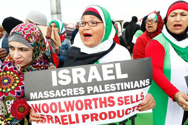 Pro-Palestinian Protestors supporting the Boycott Divestment and Sanctions (BDS) campaign against Israel, demonstrates ahead of Pharrell Williams concert outside Grand West Arena on Sept. 21, 2015 in Cape Town, South Africa.