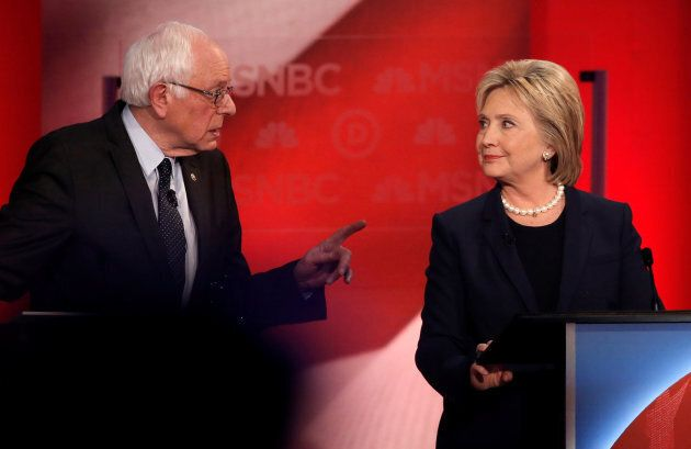 Sen. Bernie Sanders speaks to Hillary Clinton during a Democratic presidential candidates debate at the...