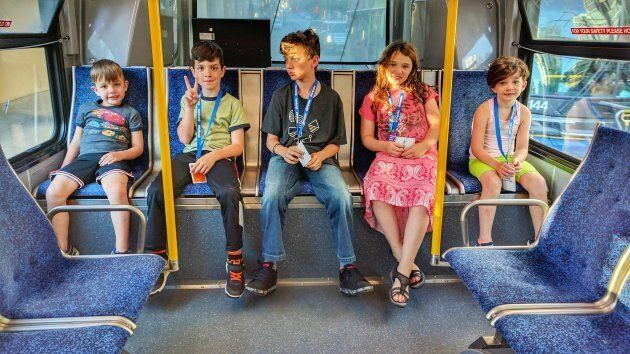The kids (including the littlest one), chilling at the back of the bus, on our way to English